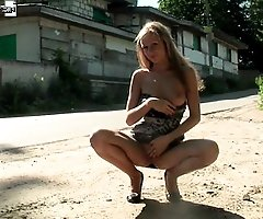 Adorable teen blondie posing naked in the ghetto