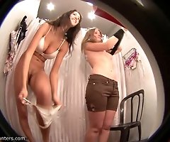 Spying on two babes who try on bikinis