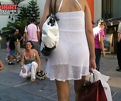 Panty upskirt - brunette in white dress voyeured