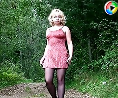 Stockinged blonde makes water on a quiet forest road