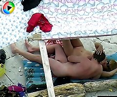 Nude couple enjoys some oral on a nude beach