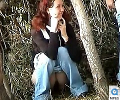 Dirty chicks take a leak among trees
