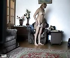 Undressing mature chick gets filmed by a voyeur