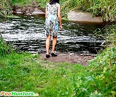 Cute babe plays watersports on a quiet forest glade